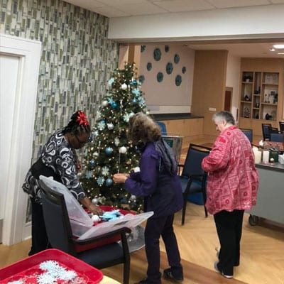 seniors decorating a christmas tree at Lutherans towers